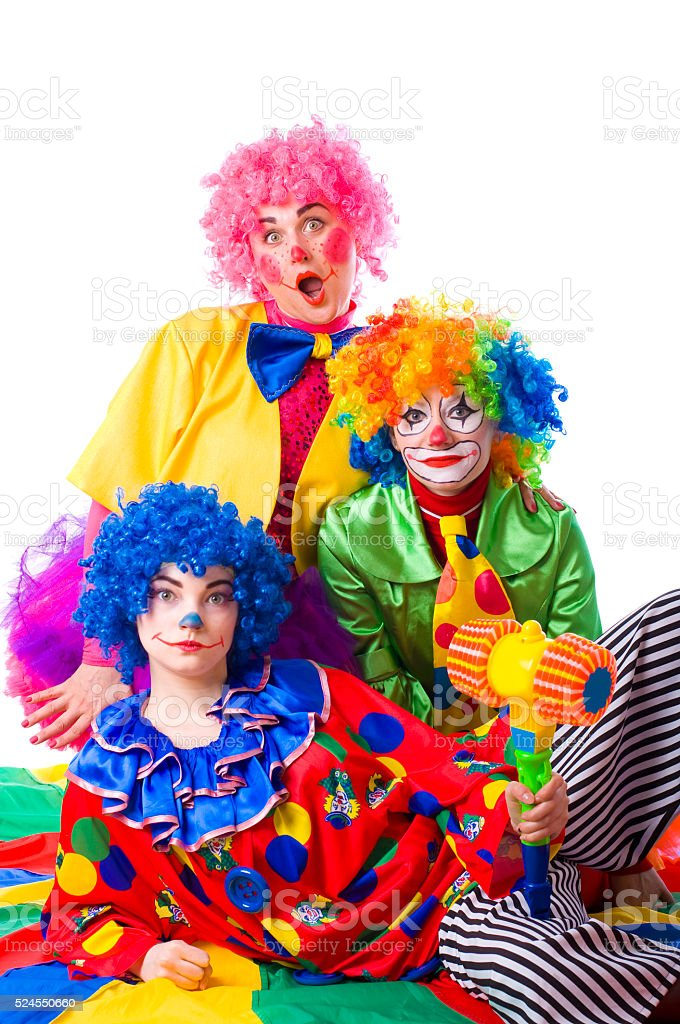 Three colorful funny clown on a white background stock photo