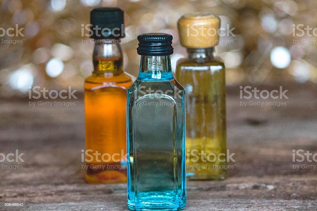 Three Colorful Minibar Bottles of Alcohol stock photo