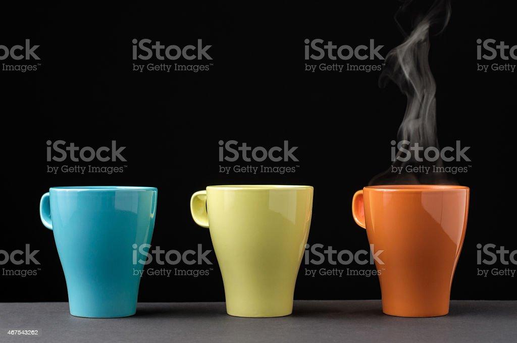 Three colorful mug with steam stock photo