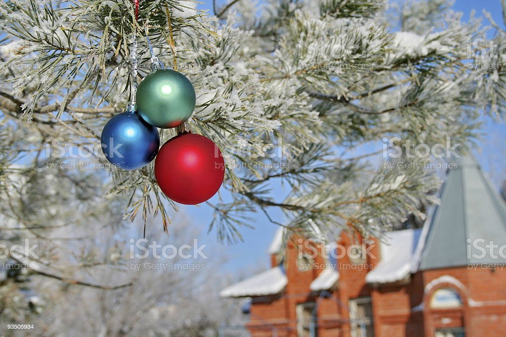 Three colour balls on a pine royalty-free stock photo