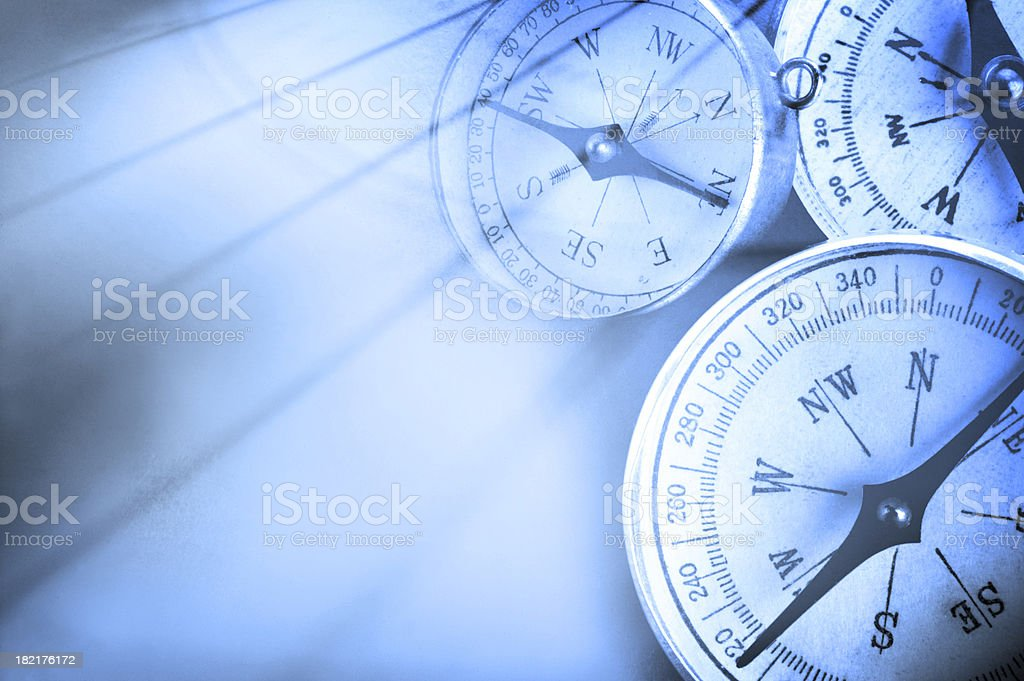 Three Compasses With Geographical background royalty-free stock photo
