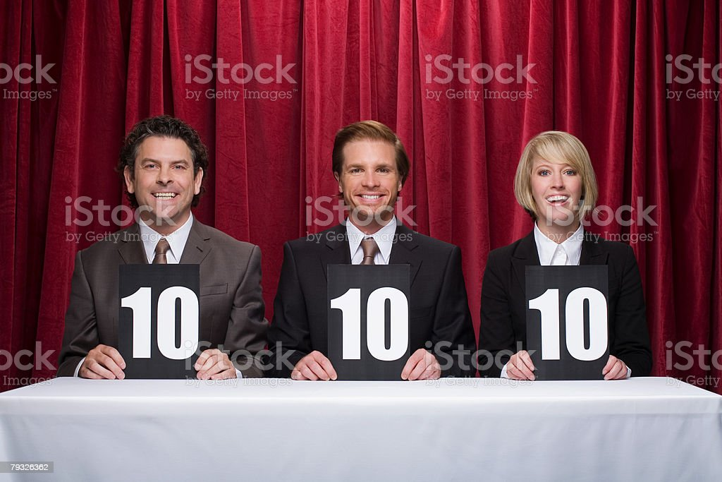 Three competition judges stock photo