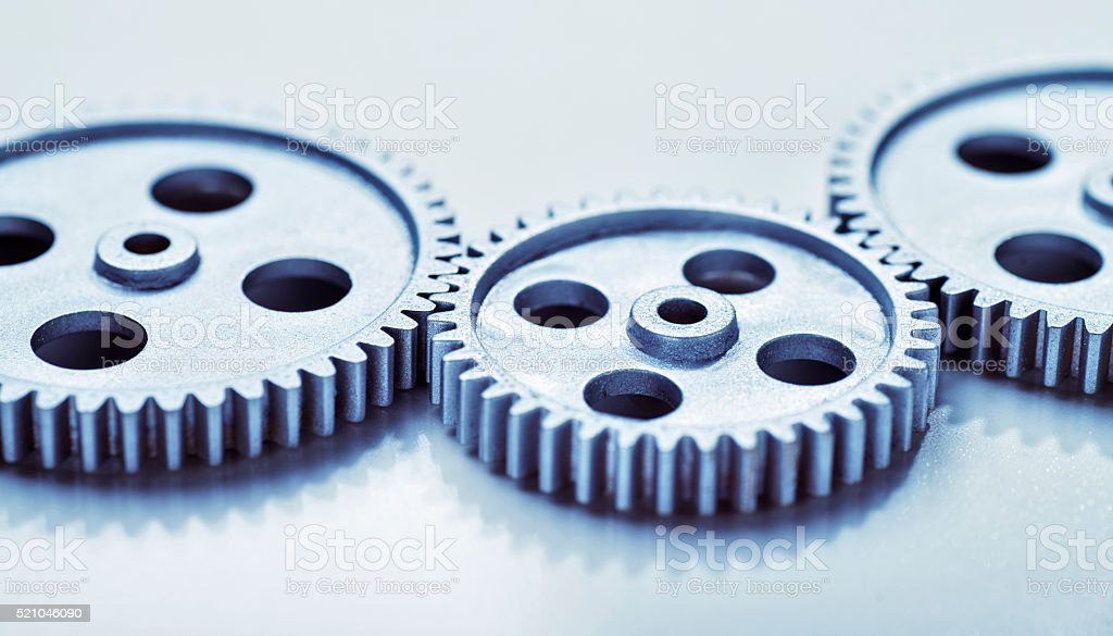 Three connected gears stock photo