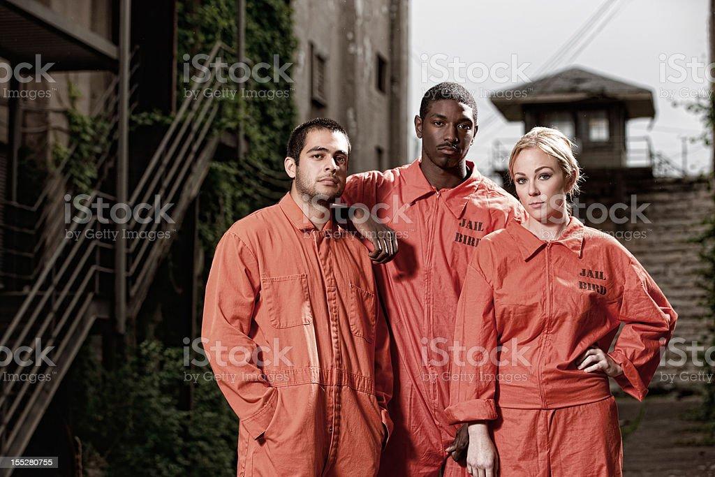 Three Convicts in the Prison Yard stock photo