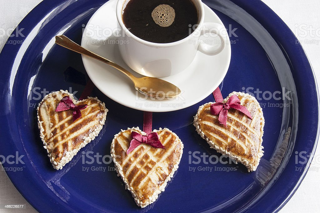 Three cookies in shape of heart and cup cofee royalty-free stock photo