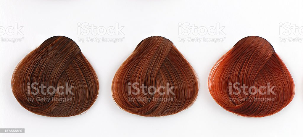 three copper hair swatches stock photo