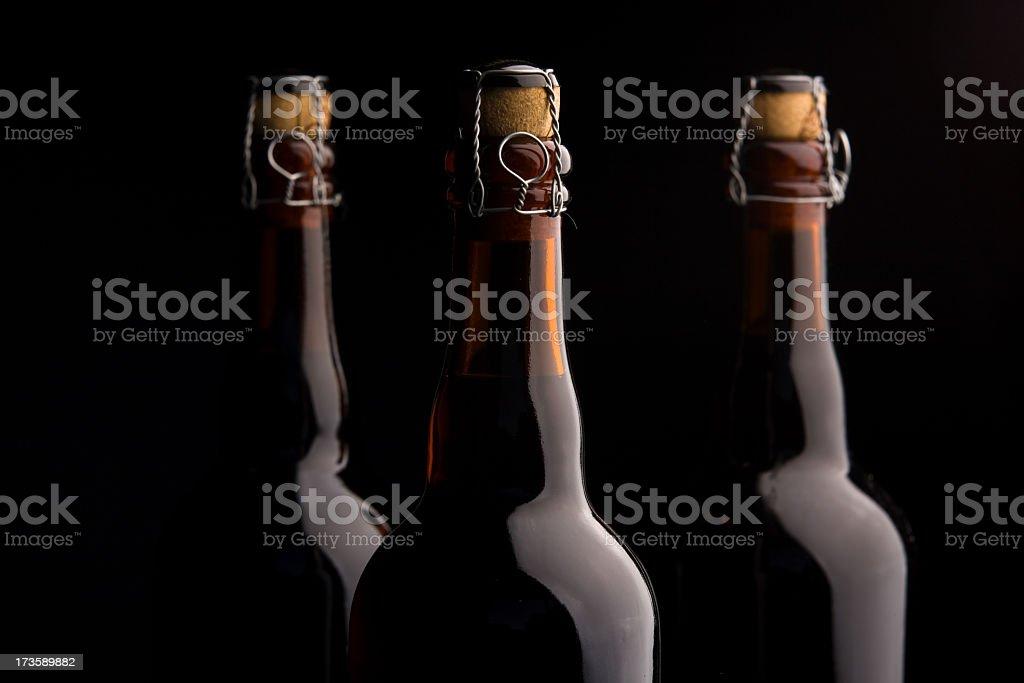 Three corked beer bottles stock photo