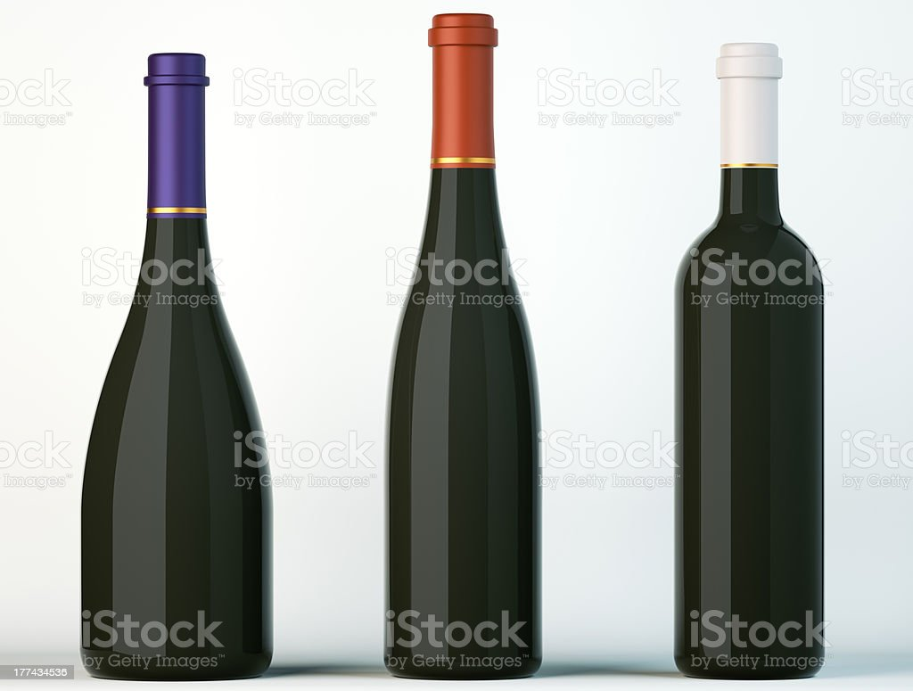 Three corked black bottles for wine or beverages stock photo
