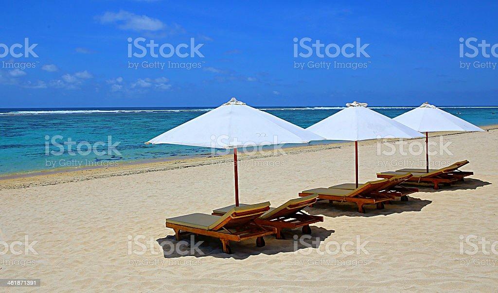Three covered canopies on beach stock photo