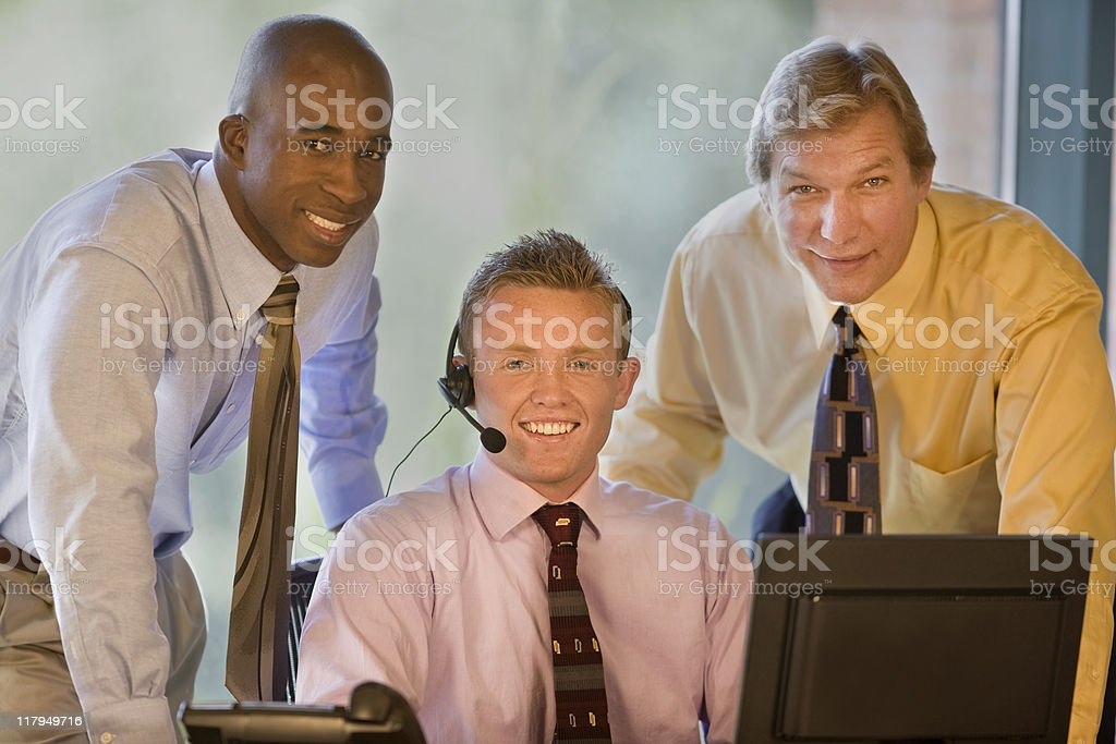 Three Co-workers In The Office Smiling royalty-free stock photo