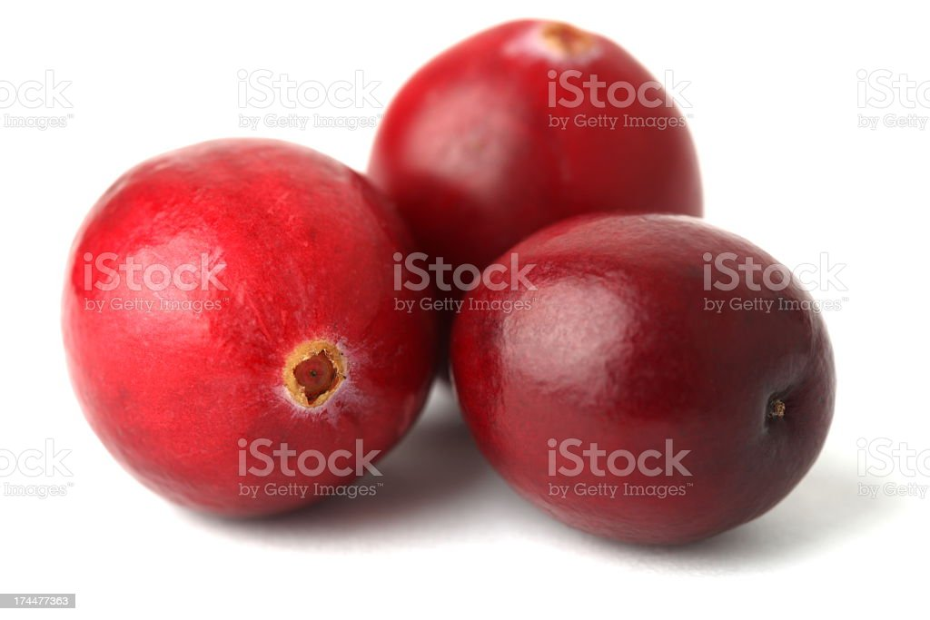 Three cranberries on a white background royalty-free stock photo