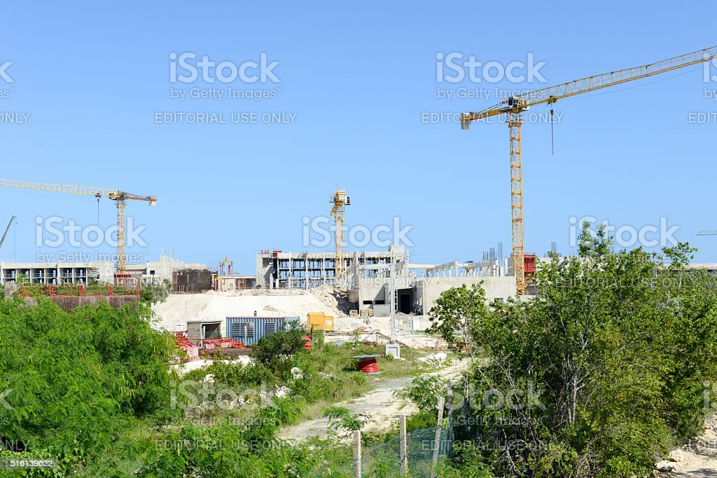 Three cranes on a construction site of a new hotel stock photo