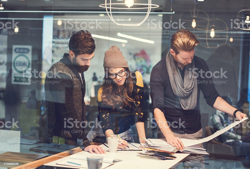 Three creative people working in the office. stock photo