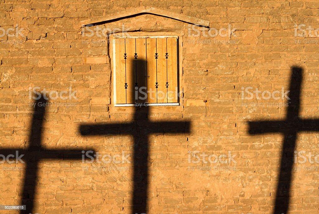 Three Crosses (Shadows) Against Bright Adobe Church, New Mexico stock photo