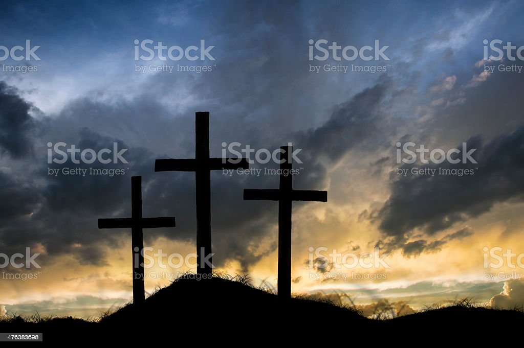 Night falls over the empty crosses from the day of Jesus\' crucifixion.