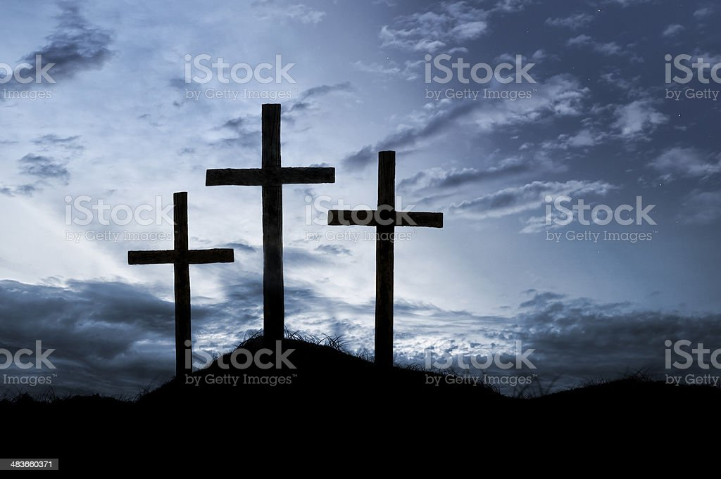 Night falls over the empty crosses from the day of Jesus\'...