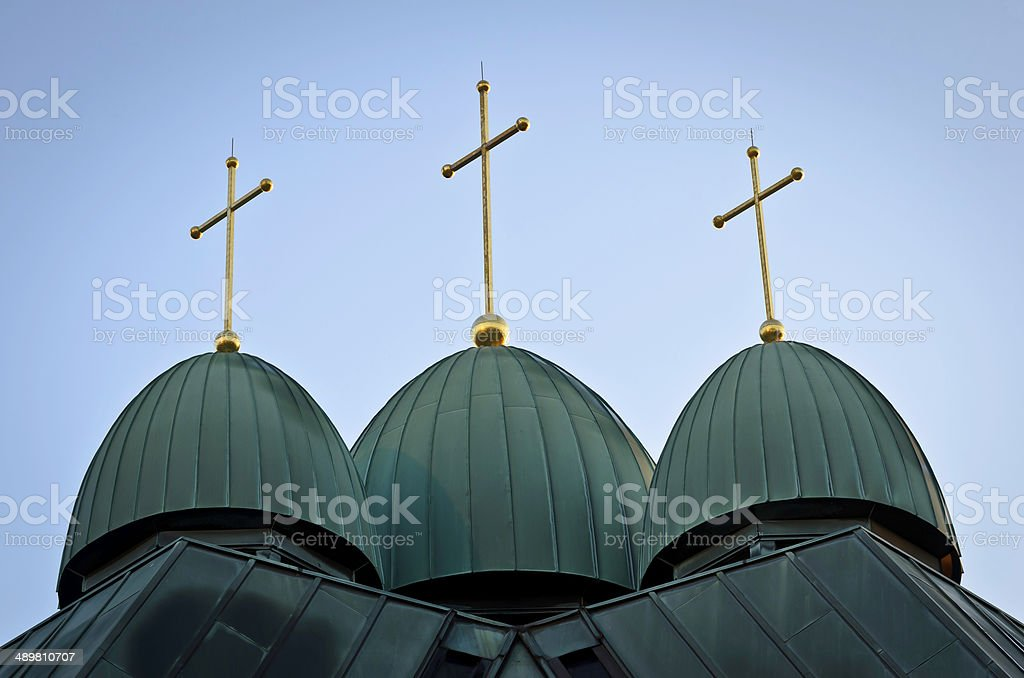 Three crosses on a church roof royalty-free stock photo