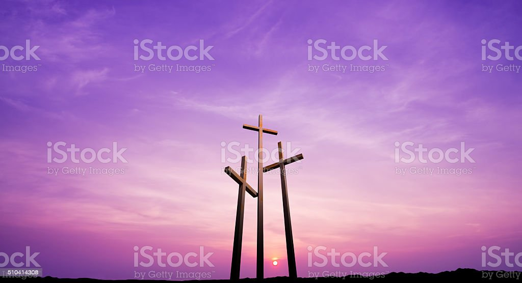 Three crosses on a hill over bright sky stock photo