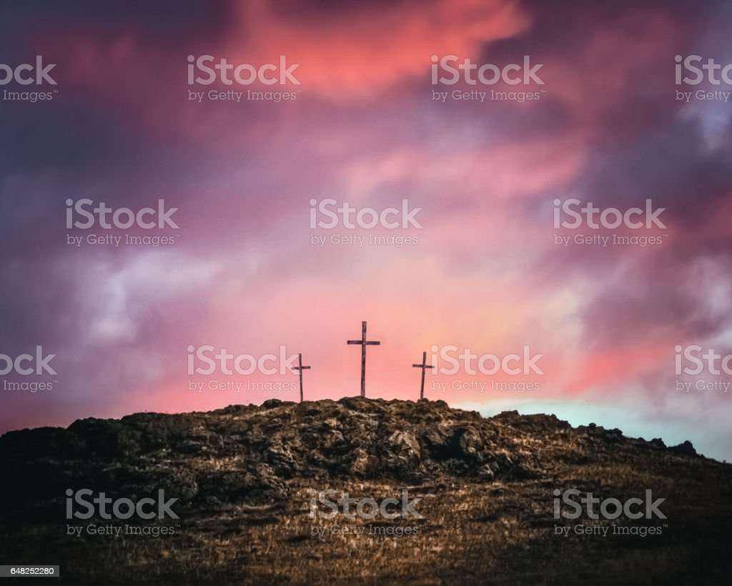 Three Crosses On A Rocky Hill stock photo