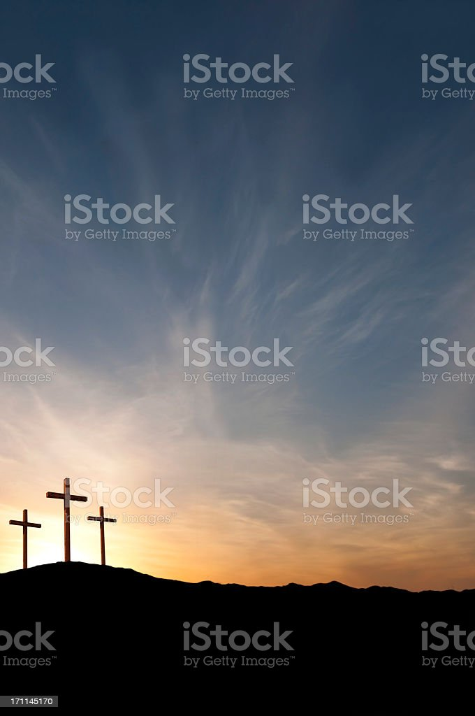 Three Crosses on Good Friday With Dramatic Sunset- Copy stock photo