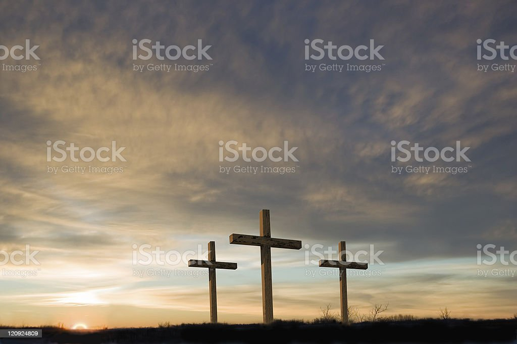 Three crosses on Good Friday with setting sun and  copy. royalty-free stock photo
