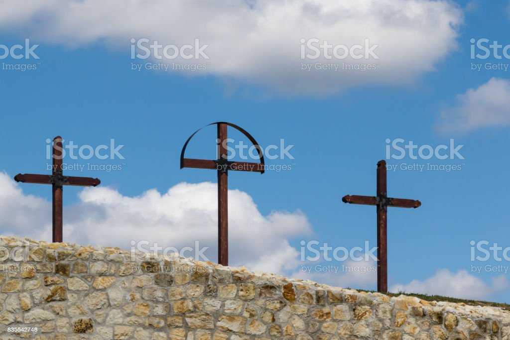 three crosses on hill stock photo
