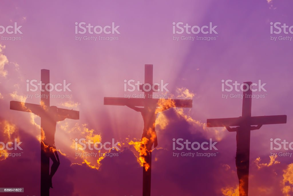 Three crosses over bright cloudy sky stock photo