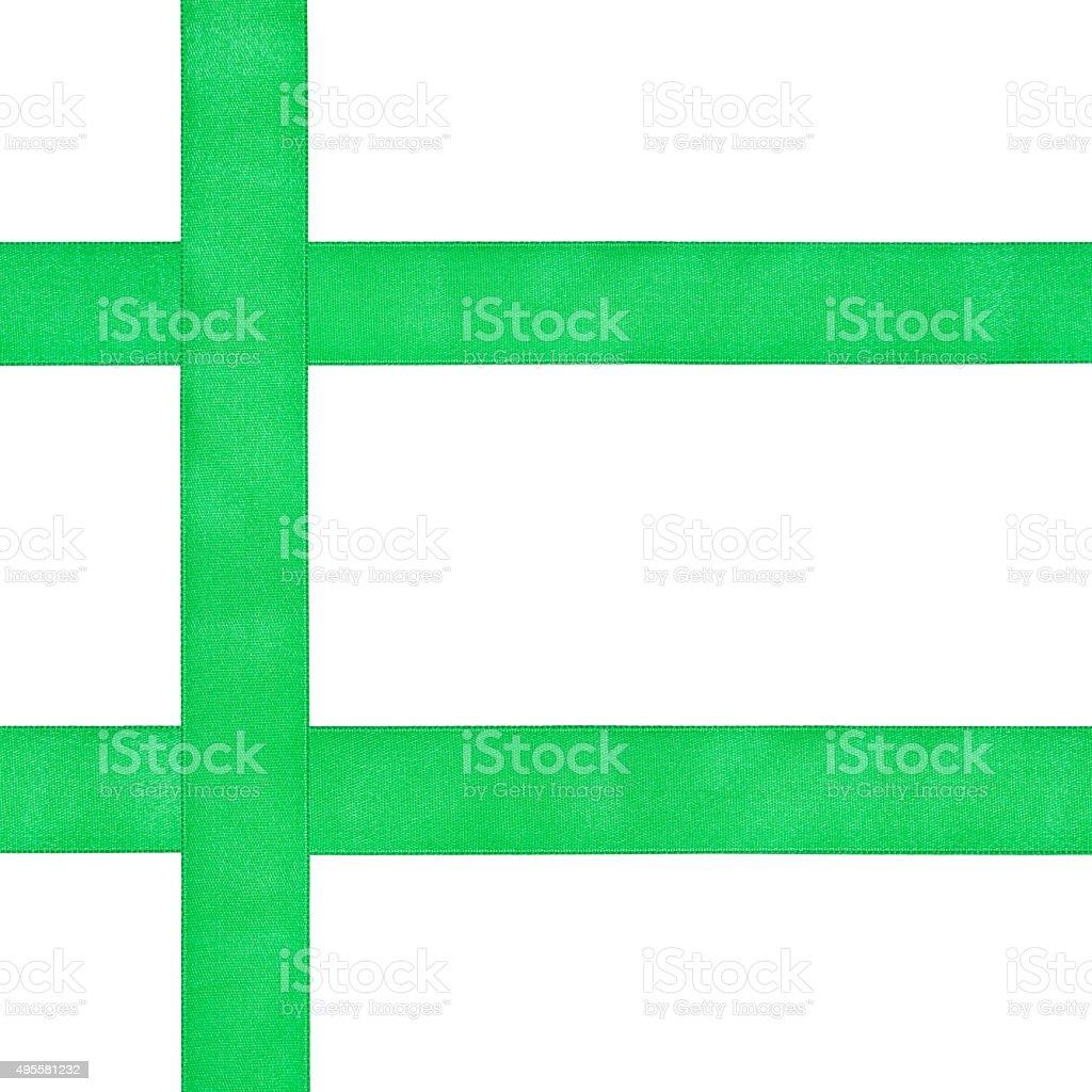 three crossing green satin ribbons isolated stock photo