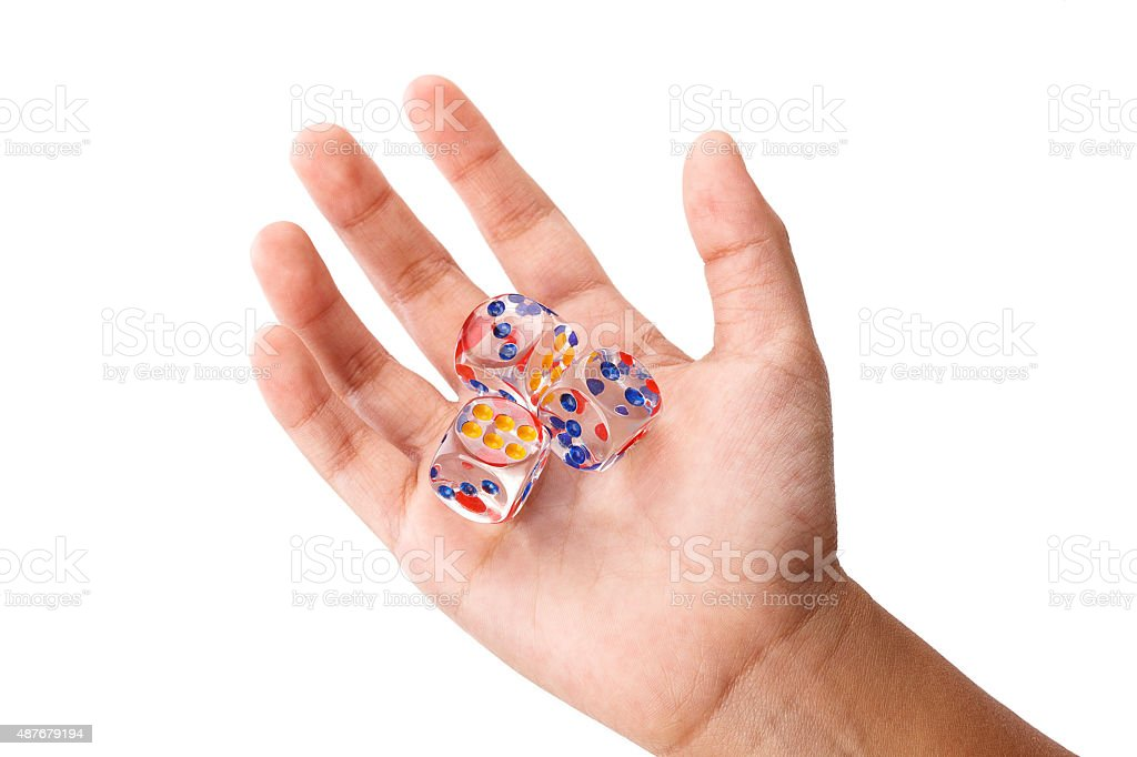 Three crystal dices in kid hand stock photo