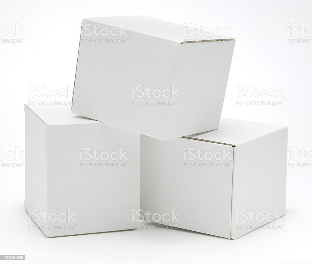 Three cube shaped blank white cartons isolated royalty-free stock photo
