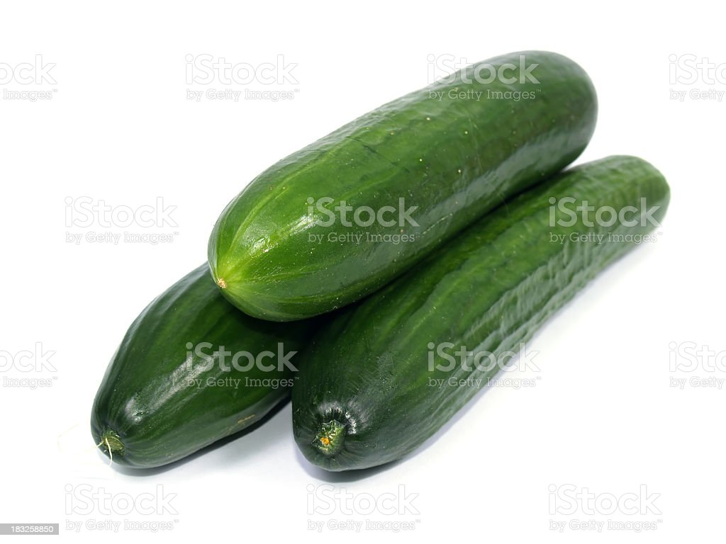 Three cucumbers on white background stock photo