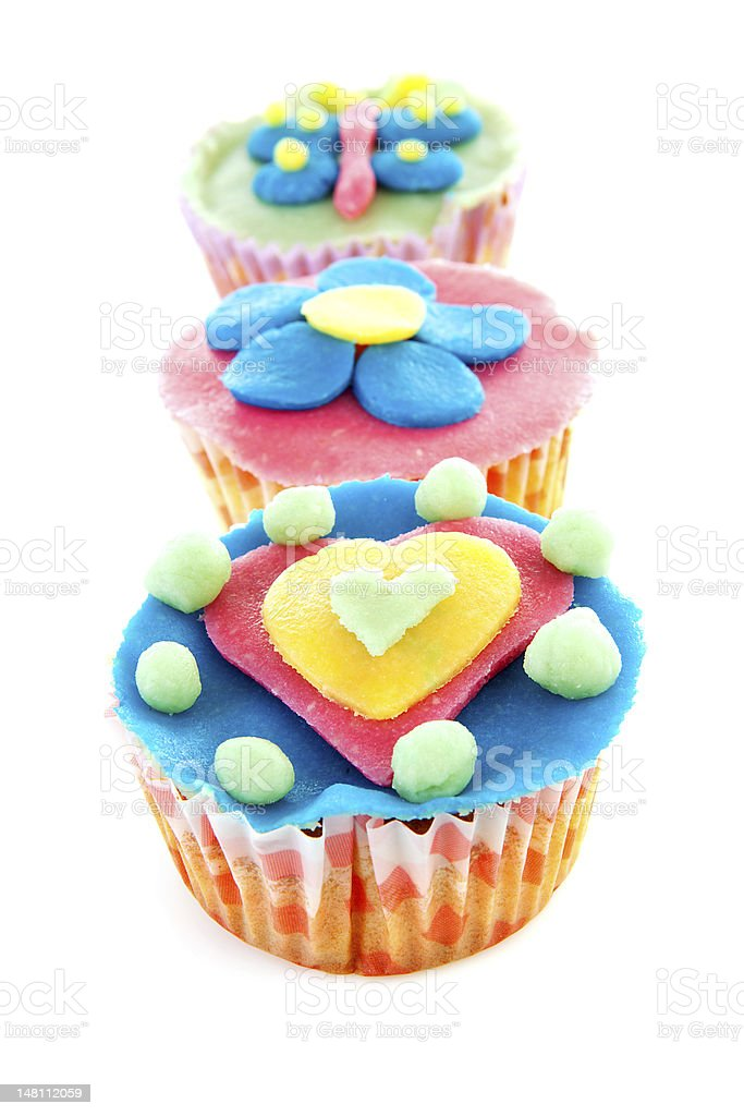 three cupcakes with marzipan decoration royalty-free stock photo