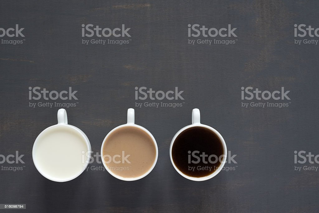 Three cups with coffee and milk stock photo