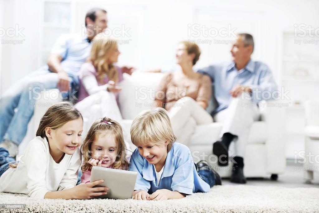 Three cute kids using a digital tablet. royalty-free stock photo