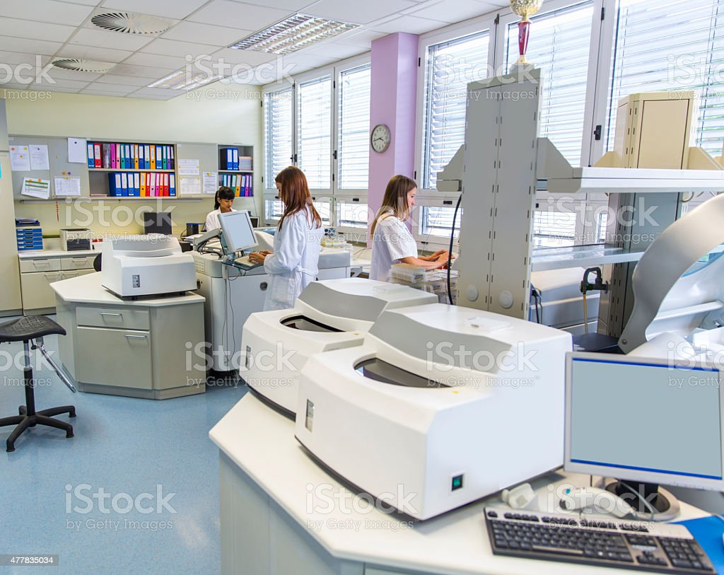 Three cute Technicians in laboratory of blood bank stock photo