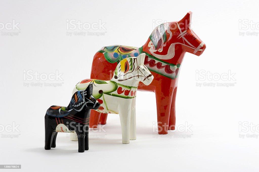 Three Dala Horses on White Background stock photo