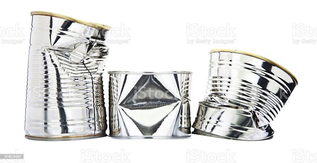 Three damaged metallic tin cans stock photo