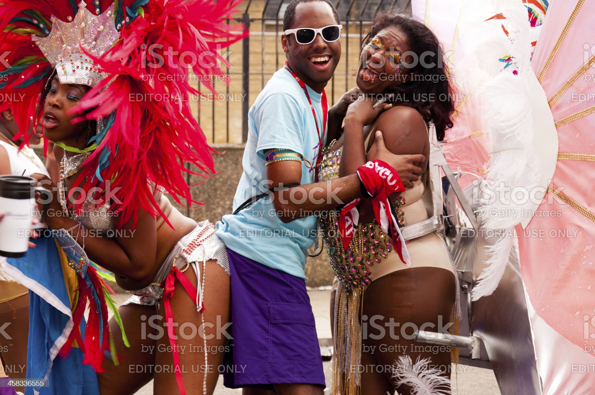 Three dancers in Notting hill carnival 2012 royalty-free stock photo