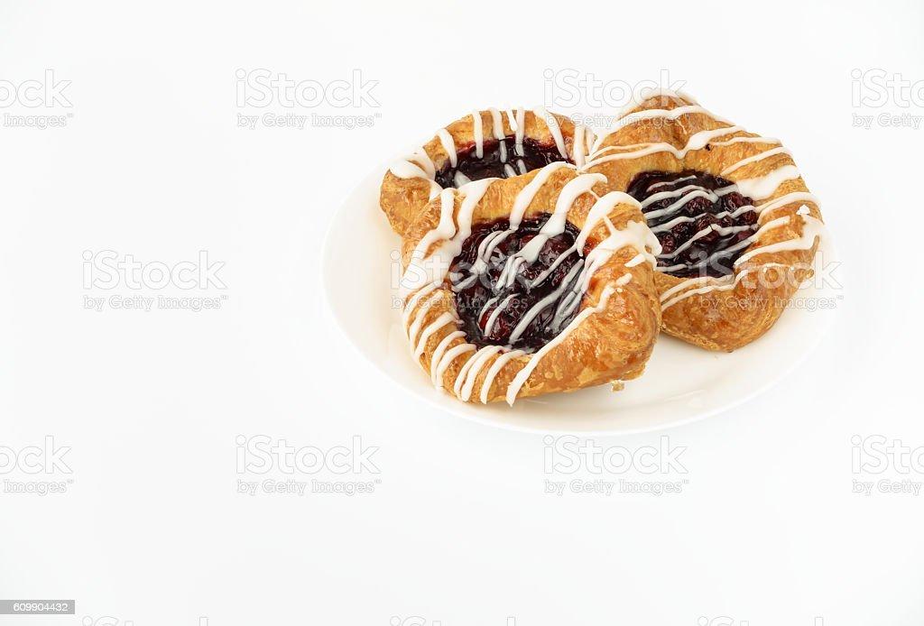 Three Danish Cherry Pastries on White Plate stock photo