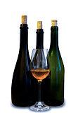 Three dark bottles with glass of wine