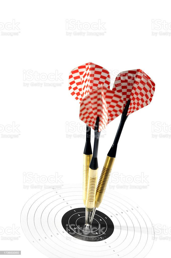 Three darts aimed in the centre of dartboard royalty-free stock photo