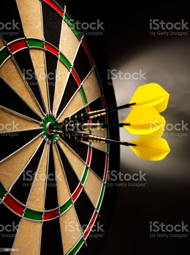 Three Darts in a Bull's Eye royalty-free stock photo