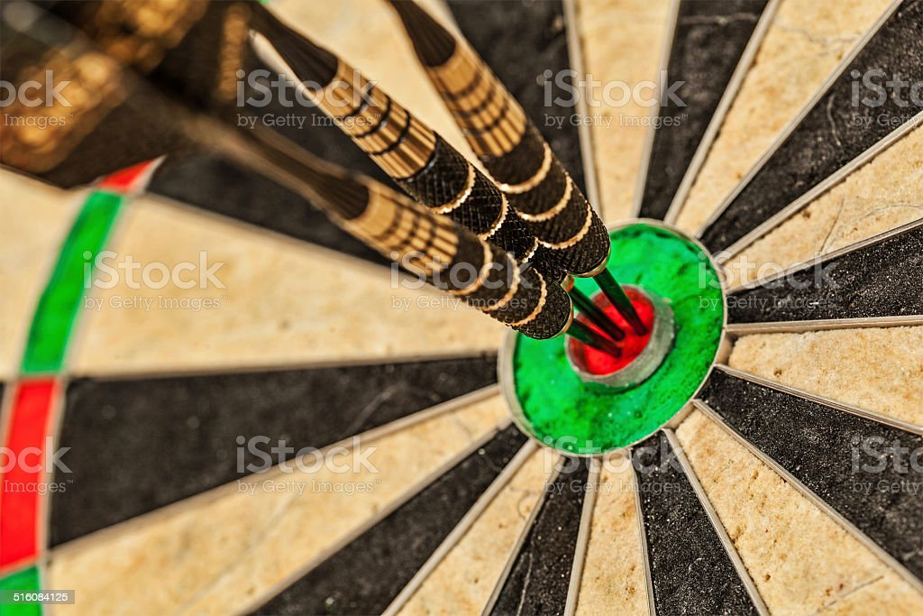 Three darts in bull's eye close up stock photo