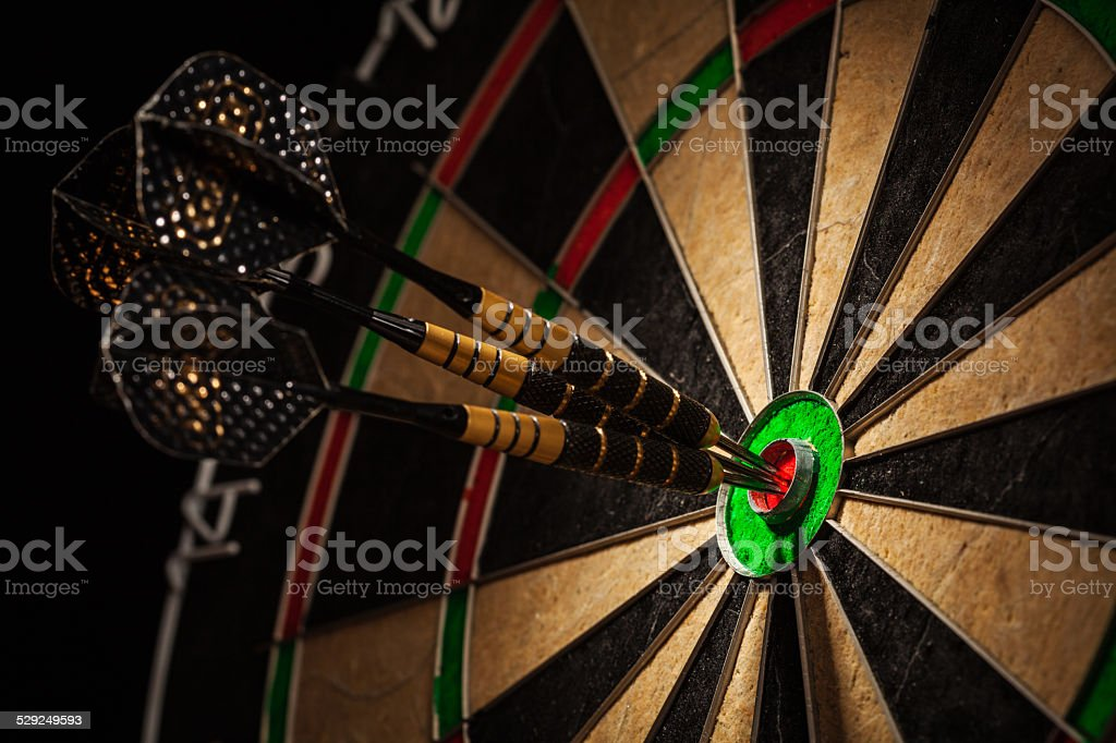 Three darts in bull's eye close up stock photo
