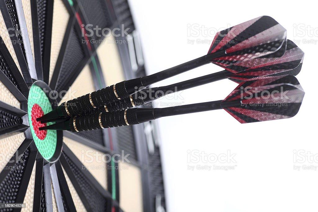Three darts in bull's eye, isolated royalty-free stock photo