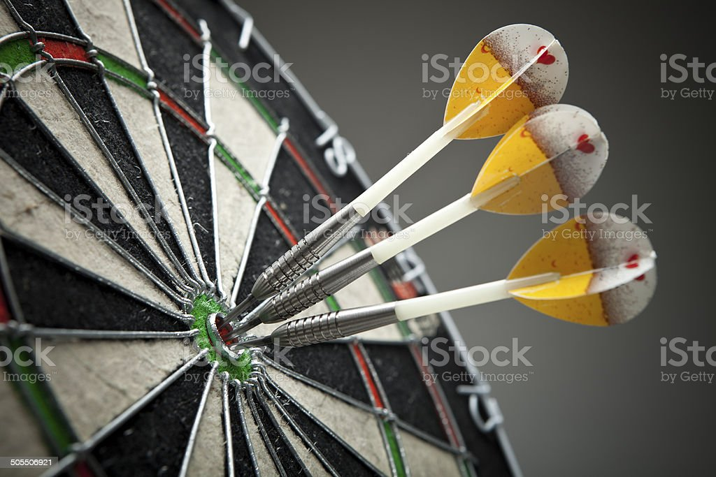 Three darts in the target center stock photo