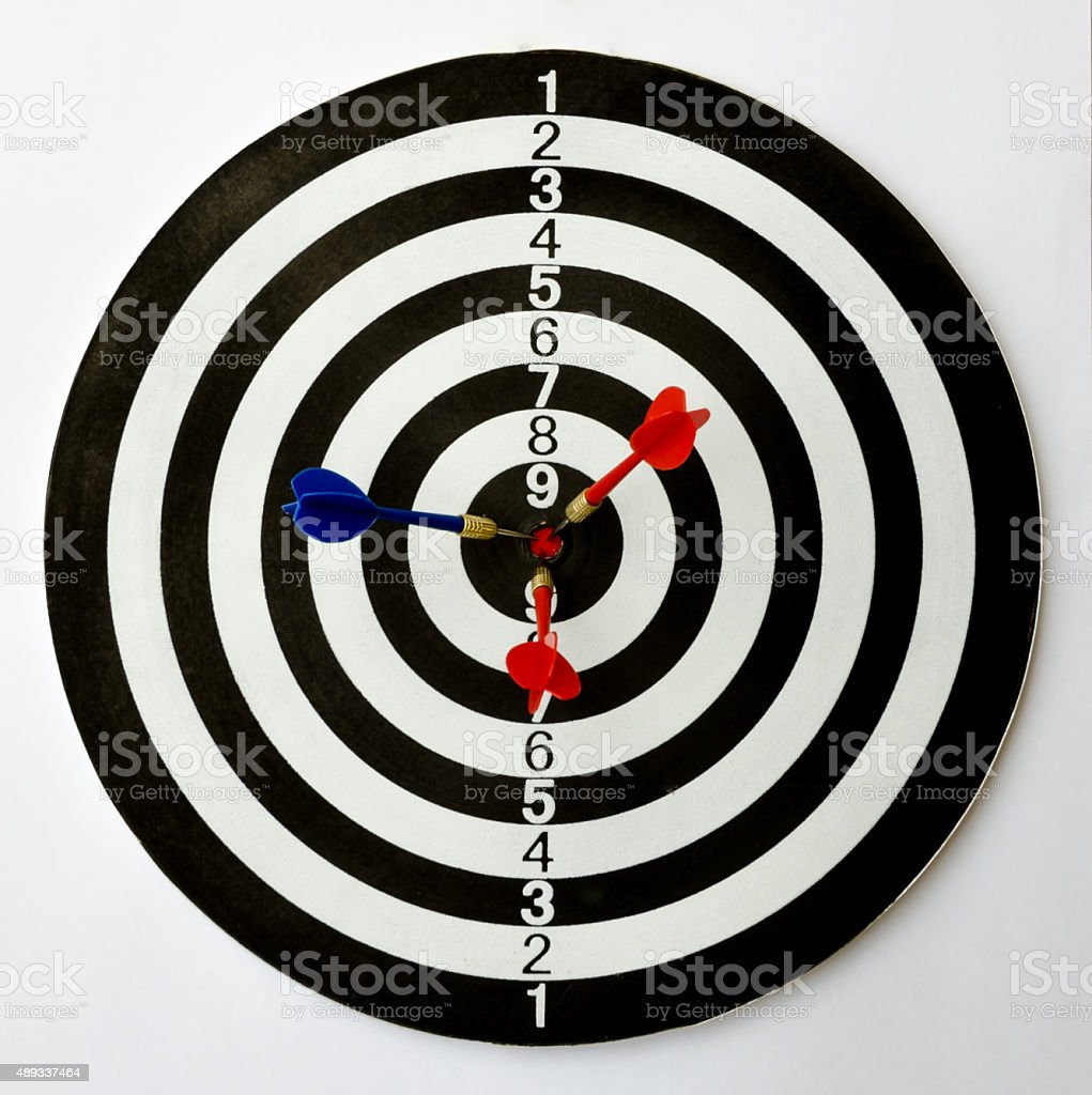 Three darts on a bullseye. stock photo