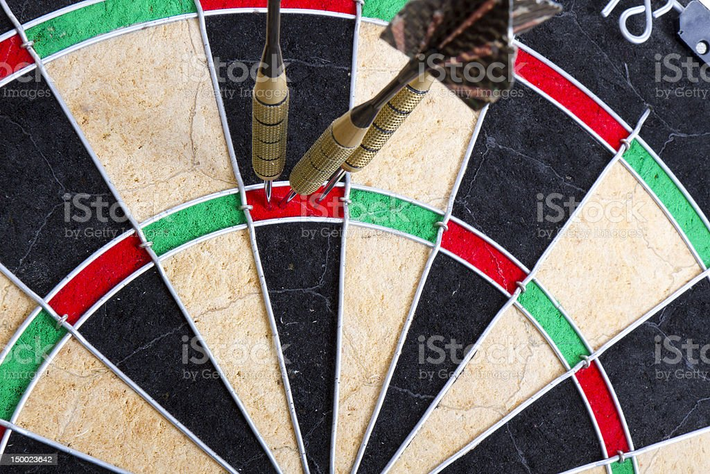 Three darts on the target royalty-free stock photo