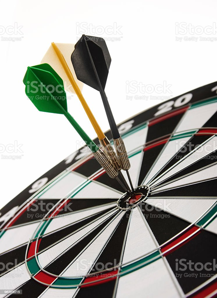 Three darts perfectly on target on a dartboard stock photo