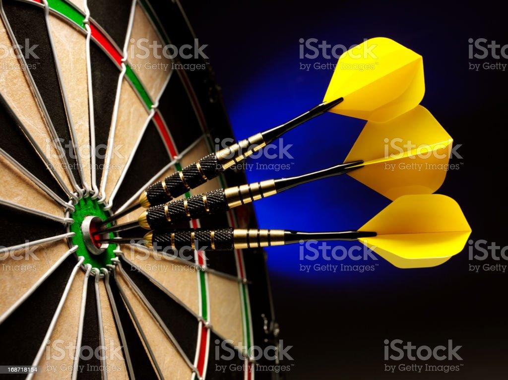 Three Darts Scoring a Bulls Eye royalty-free stock photo